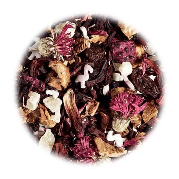 Genial Genießen - Jetzt ist die beste Zeit zum glücklich sein Tee. Früchtetee mit Ananas-Himbeer-Holunder Note und rosa Zucker-Flamingos. Detailaufnahme.