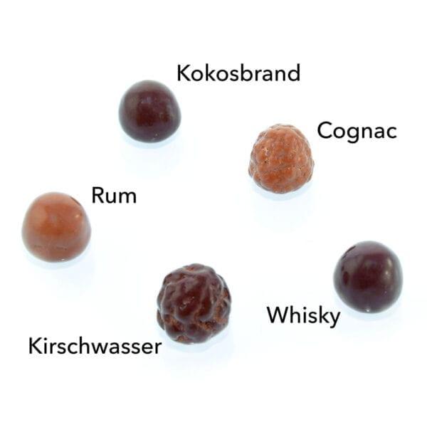 Genial Genießen Erlesene Brände mit Whisky-, Rum-, Kirschwasser-, Cognac-, Kokosfüllung. Übersicht.